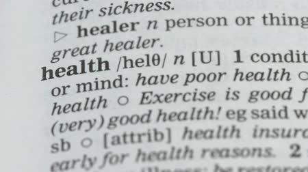 glossary : Health, pencil pointing word in dictionary, condition of body and mind, care