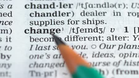 glossary : Change word definition in english dictionary, becoming different, new life Stock Footage