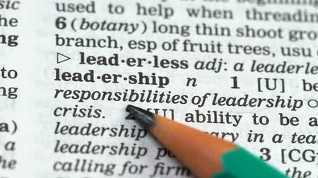 transcription : Leadership, pencil pointing word in english vocabulary, ability to guide people Stock Footage