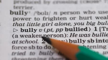 transcription : Bully, word in english vocabulary, person using force to humiliating people