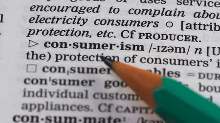 glossary : Consumerism word meaning in vocabulary, unnecessary extensive goods purchasing Stock Footage