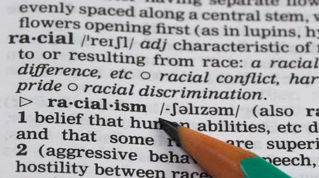 glossary : Racialism word definition in dictionary, aggressive attitude to different races