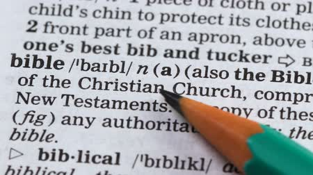 terminology : Bible, pencil pointing word in vocabulary, main christian book, belief in god