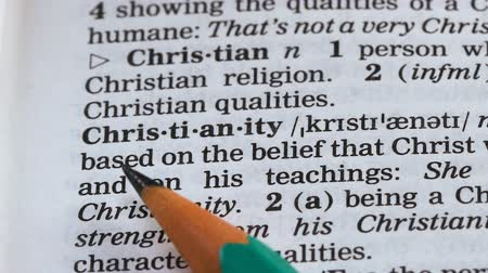 terminology : Christianity word definition written in dictionary, one of main religions, faith
