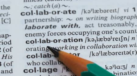 terminology : Collaboration word definition pointed in dictionary, mutual project, cooperation Stock Footage
