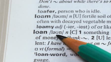 transcription : Loan, meaning in english vocabulary, purchasing real estate, money for business Stock Footage