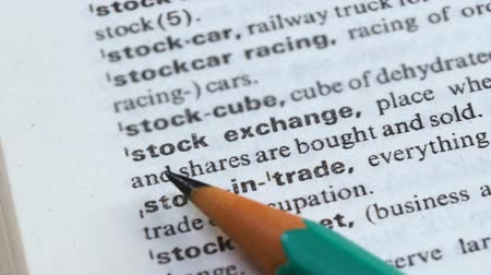 transcription : Stock exchange phrase in english dictionary, bonds selling and purchasing, trade