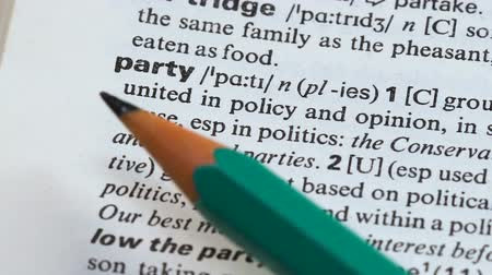 transcription : Party word definition on vocabulary page, political group united in opinion