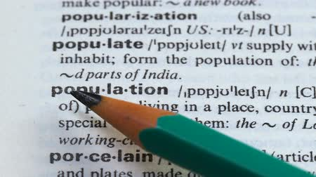 grammatica : Population, pencil pointing definition, people living in one place or country