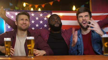 kaybetmek : Black and caucasian friends unhappy with american team losing match, time in pub