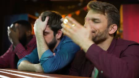 facepalm : Multi ethnic football fans making facepalm, disappointed with game loss.