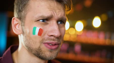 facepalm : Disappointed football fan with italian flag on cheek making facepalm, failure Stock Footage