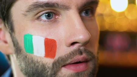facepalm : Italian male fan making face palm gesture, upset about favorite team losing game Stock Footage