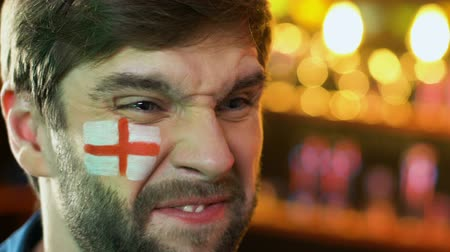 facepalm : Male football fan with English flag on cheek upset about favorite team loss
