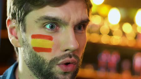 facepalm : Spanish male fan making facepalm gesture, upset about favorite team losing game Stock Footage