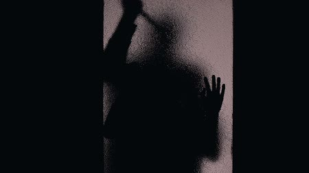 abused : Helpless female silhouette knocking door, maniac killing victim with knife