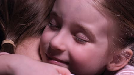 foster : Smiling little girl hugging mother, tender relations in family, love and care Stock Footage