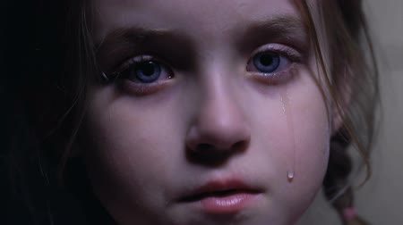 smutek : Little cute girl crying desperately, violations of child rights, defenseless kid