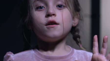 witness : Beautiful little girl suddenly frightened, spooky night, phobia of darkness Stock Footage