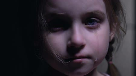 maltreatment : Beautiful little girl crying, defenseless victim of kidnapping, child abuse Stock Footage