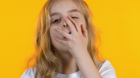 embarrassed : Girl making facepalm, youthful maximalism, awkward age, bright background