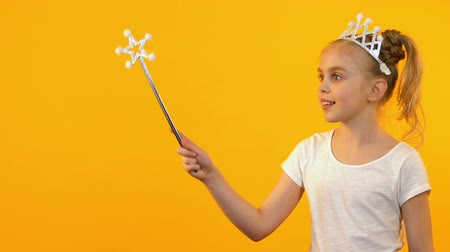büyücü : Beautiful princess girl waving magic wand and smiling at camera, happy childhood Stok Video