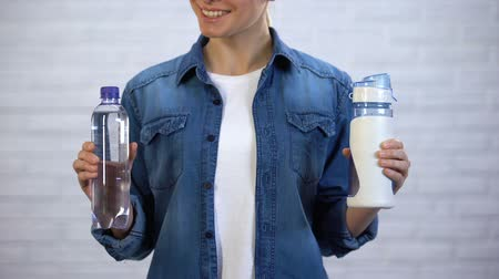 drinking water supply : Female choosing reusable flask instead disposable bottle, plastic pollution