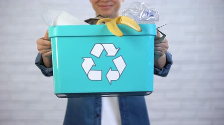 litter box : Person holding trash bin with disposable and plastic garbage, waste sorting