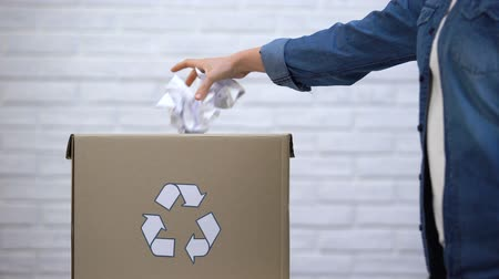 litter box : Person throwing paper into trash bin, waste sorting concept, recycling system