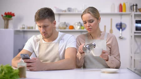 jealous : Jealous woman peeping in husbands smartphone, relationship crisis, distrust