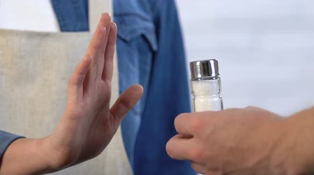 recusar : Woman rejecting salt, choosing salt-free diet for healthy nutrition, lifestyle Stock Footage