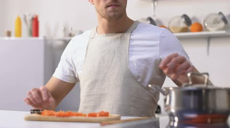 lids : Hungry guy opening pan lid and feeling disgusting smell, rotten products. Stock Footage