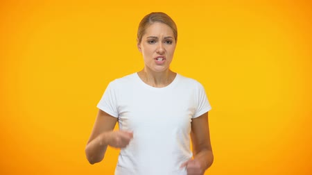 bossy : Upset female in white t-shirt swearing, dissatisfied client, problem annoyance Stock Footage