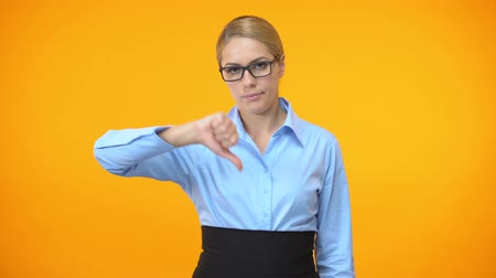 erros : Disappointed female boss showing thumbs down, project failure, mistake gesture.