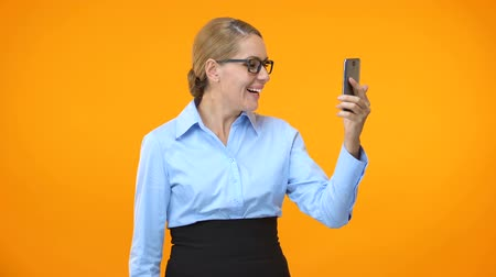 igen : Excited company employee showing yes gesture reading smartphone email, success