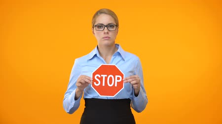 proibir : Young business lady holding stop sign hands, sexual harassment at work, protest Vídeos