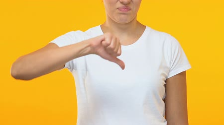 displeasure : Beautiful female showing thumbs down gesture, consumer service review, dislike