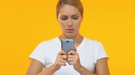 unlucky : Woman using smartphone, upset about faulty gadget or application, technology Stock Footage