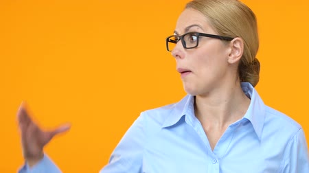 attitude : Irritated business woman showing blah blah gesture, distrustful information Stock Footage