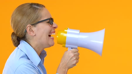 irritate : Unsatisfied female manager shouting in megaphone, workers rights, protest