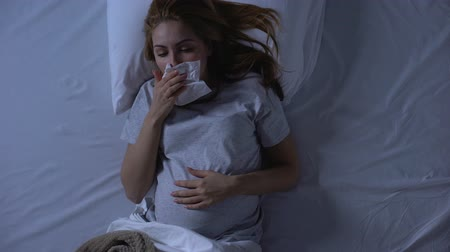 vomit : Exhausted pregnant female suffering nausea, wiping mouth with tissue, weakness Stock Footage