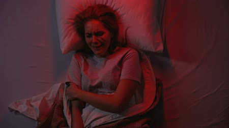 yara : Injured young woman crying in bed at night, domestic violence, desperation