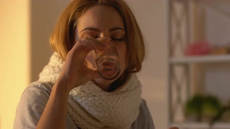 coughing : Coughing woman in scarf drinking syrup, treatment during flu virus disease Stock Footage