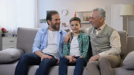 parentes : Happy grandpa, dad and son looking to camera, social insurance, happy family