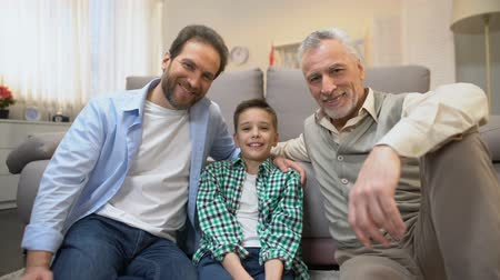 poll : Multiage male family members looking to camera, family demography statistics