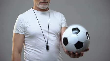 motive : Adult athletic soccer coach playing with ball, active lifestyle, sports activity Stok Video