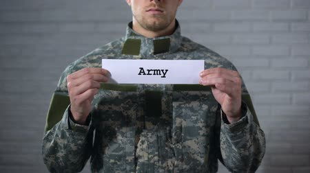 охранять : Army word written on sign in hands of soldier, country protection, defense