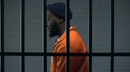 culpado : Nervous black prisoner walking in cell, serve in solitary cell, drug dealer Stock Footage