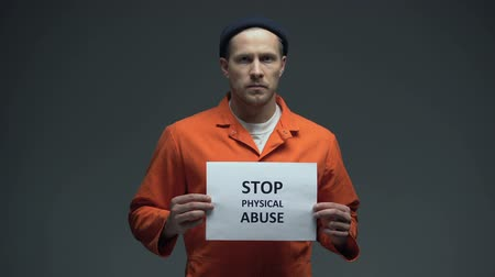 hostility : Caucasian imprisoned prisoner Stop physical abuse sign, sexual harassment
