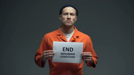 penas : Prisoner holding End inhuman conditions sign in cell, human rights protection